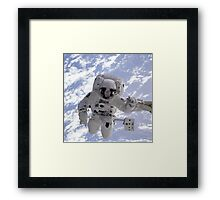 Astronaut Above Earth During Spacewalk Framed Print