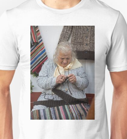 An old lady sits and knits in a square in Madeira Unisex T-Shirt