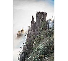 Hard rock against soft clouds Photographic Print
