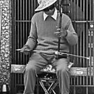 Chinatown Musician with His Erhu Instrument by Buckwhite