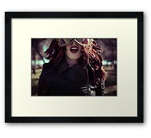 Sensual brunette woman with flowing hair and jacket with golden wings Framed Print