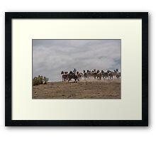 Bringing up the horses Framed Print