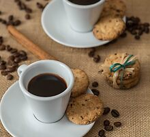 Homemade cookies , coffee and cinnemon om gray background by JPopov
