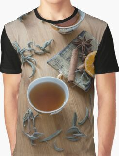 Tea, dried cinnamon,orange and anise on wooden background Graphic T-Shirt