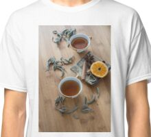 Tea, dried cinnamon,orange and anise on wooden background Classic T-Shirt