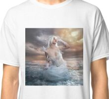 the forces of nature, blonde woman on the rocks with the sea raging and powerful Classic T-Shirt