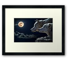 Wolves of the moon Framed Print
