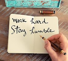 Motivational concept with handwritten text WORK HARD STAY HUMBLE by Stanciuc