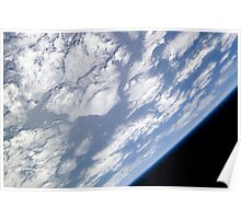 A blue and white part of Earth and the blackness of space viewed from the Earth-orbiting space shuttle Atlantis. Poster