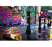 Bollards in a Rainy Graffiti Lane Photographic Print
