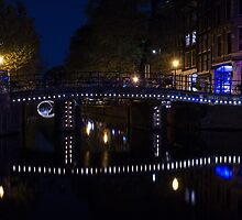 Magical Amsterdam Night - Blue, White and Purple Lights Symmetry by Georgia Mizuleva