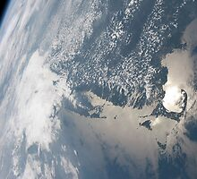 Sunglint on the waters of Earth. by StocktrekImages