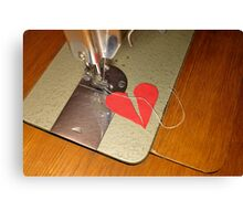 tailor try to sew two halves of broken heart together Canvas Print