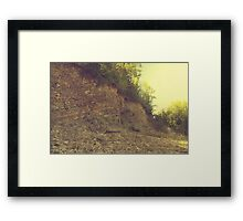 Rock hill with mud and plant Framed Print