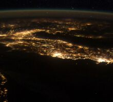 Nighttime panorama showing city lights of Europe. Sticker