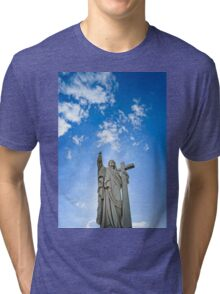 Majestic Jesus Christ sculpture over little french village, Maisonsgoutte, France Tri-blend T-Shirt