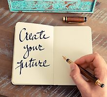 Motivational concept with handwritten text CREATE YOUR FUTURE by Stanciuc