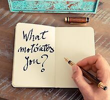 Motivational concept with handwritten text WHAT MOTIVATES YOU by Stanciuc