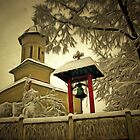 A digital painting of the village church in Winter, Barda, Mehedinti, Romania by Dennis Melling