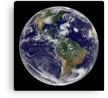 View of the full Earth and four storm systems. Canvas Print
