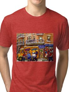 THE COMIC BOOK SHOP CANADIAN URBAN SCENES MONTREAL ART QUEBEC PAINTINGS HOCKEY ART WITH DELIVERY TRUCK Tri-blend T-Shirt