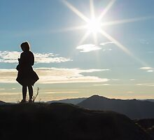 Silhouette woman on a mountain top by icsnaps