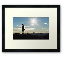 Silhouette woman on a mountain top Framed Print