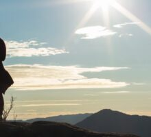 Silhouette woman on a mountain top Sticker