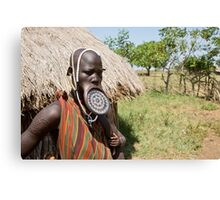 Woman of the Mursi tribe with clay lip disc as body ornaments Canvas Print