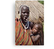 Woman of the Mursi with elongated lower lip to hold a clay disk as body ornaments Canvas Print