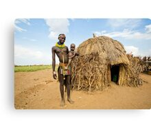 Young Nyangatom woman with baby in arms Canvas Print
