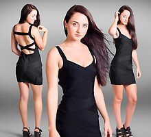 Beautiful young woman showcasing black dress  by Ryan Jorgensen