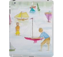 Children playing with sailboats. iPad Case/Skin