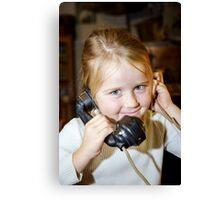 Cute preschooler girl talking by old vintage retro telephon, closeup portrait Canvas Print