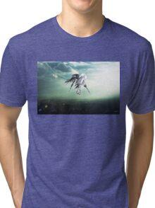 Gundam Wing above the city  Tri-blend T-Shirt