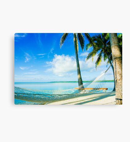 Empty hammock in warm tropical shade. Canvas Print