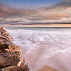 The tide and the breakwater by Ralph Goldsmith