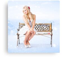Cold and lonely winter woman sitting all alone Canvas Print