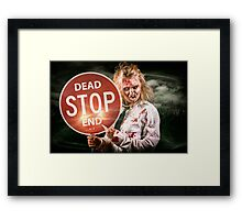 Halloween portrait. Scary zombie holding stop sign Framed Print