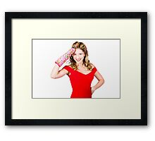 Blond pinup woman saluting in cooking glove Framed Print
