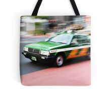 shinjuku taxi zooms by Tote Bag
