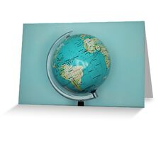 Globe and blue background Greeting Card