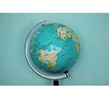 Globe and blue background Photographic Print