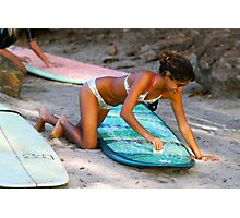 Woman Waxing a Surfboard Photographic Print