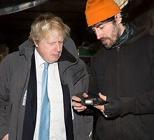 London Mayor,Boris Johnson, tests out London's largest open workshop as he tries welding a bicycle frame with Rob Quirk helping him by Keith Larby