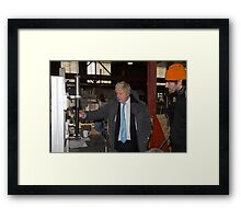 London Mayor,Boris Johnson, tests out London's largest open workshop as he tries welding a bicycle frame with Rob Quirk helping him Framed Print