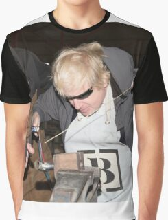 London Mayor,Boris Johnson, tests out London's largest open workshop as he tries welding a bicycle frame with Rob Quirk helping him Graphic T-Shirt