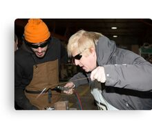 London Mayor,Boris Johnson, tests out London's largest open workshop as he tries welding a bicycle frame with Rob Quirk helping him Canvas Print