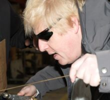 London Mayor,Boris Johnson, tests out London's largest open workshop as he tries welding a bicycle frame with Rob Quirk helping him Sticker