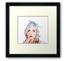 Retro style portrait of a blond girl with a bow Framed Print